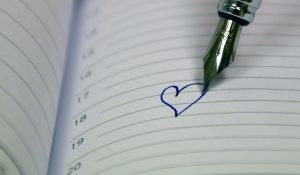 love heart in pen on notepad